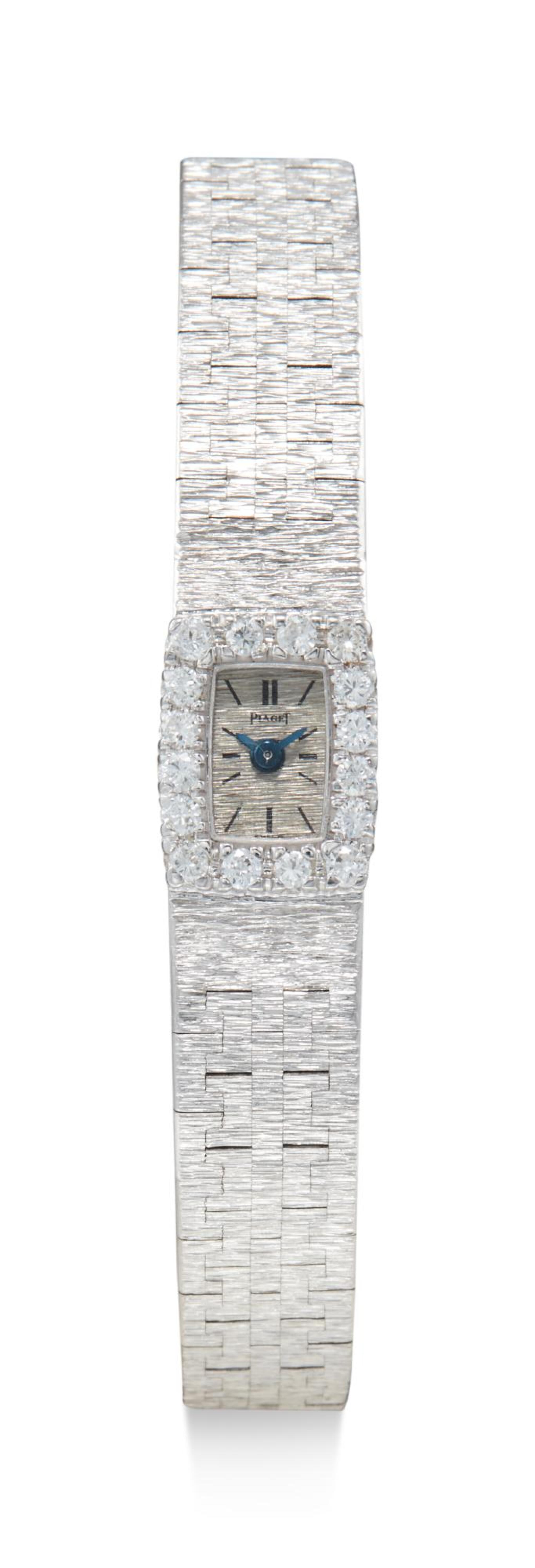 View full screen - View 1 of Lot 8091. PIAGET | REFERENCE 1308 A 6, A WHITE GOLD AND DIAMOND-SET BRACELET WATCH, CIRCA 1960.