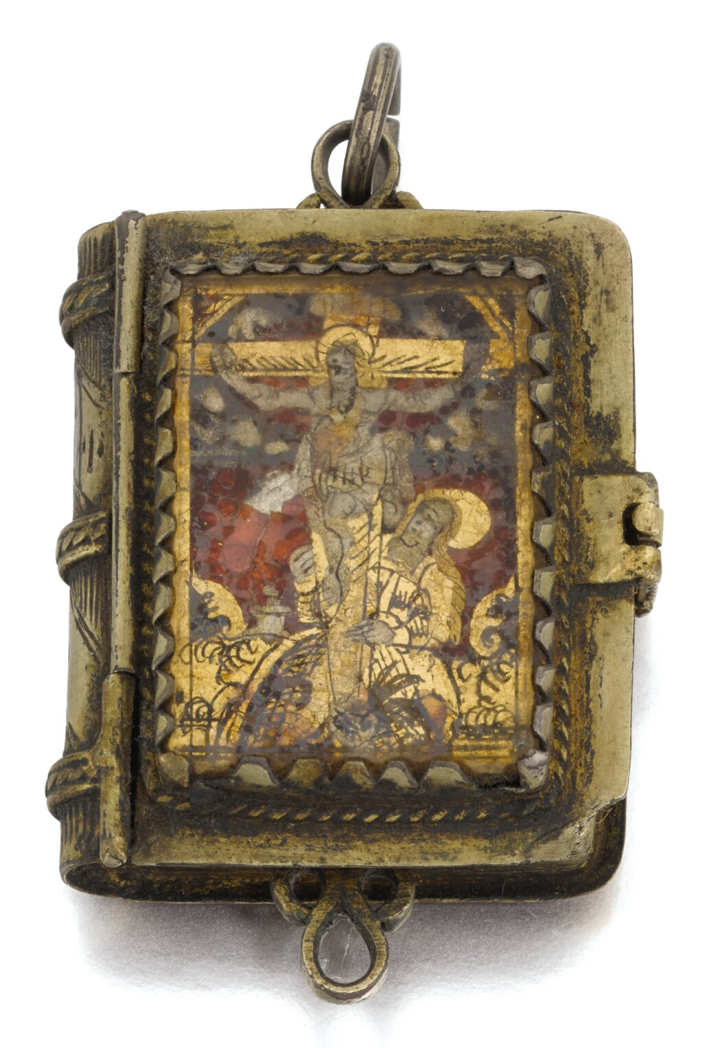 SPANISH OR ITALIAN, 17TH/ EARLY 18TH CENTURY | Miniature Prayer Book pendant with a Saint and the Crucifixion, the interior with two female saints