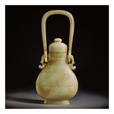 A CELADON AND RUSSET JADE ARCHAISTIC HANGING VASE AND COVER,   17TH CENTURY OR EARLIER