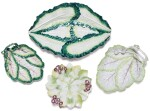 THREE LONGTON HALL CABBAGE-LEAF DISHES AND A CHELSEA DISH, CIRCA 1755