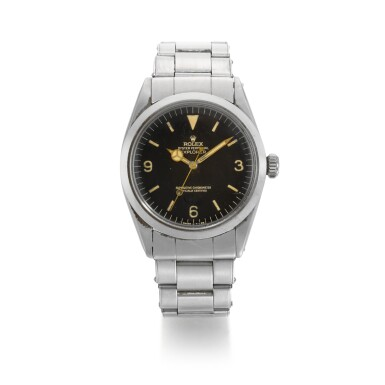 ROLEX  | EXPLORER REFERENCE 1016  STAINLESS STEEL AUTOMATIC BRACELET WATCH WITH TROPICAL DIAL  CIRCA 1964