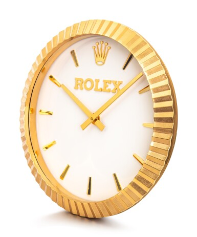 View 2. Thumbnail of Lot 8058. ROLEX, MANUFACTURED BY INDUCTA   A GILT BRASS WALL CLOCK, CIRCA 2010    勞力士,由 INDUCTA 製作   鍍金銅製掛鐘,約2010年製.