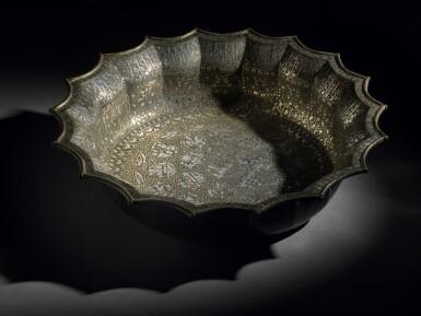 View 9. Thumbnail of Lot 74. A rare and important Khurasan silver-inlaid brass basin, probably Herat, circa 1200.