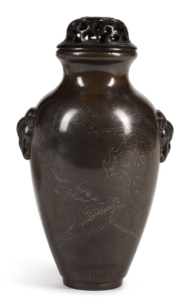 View 1. Thumbnail of Lot 52. A SMALL SILVER-INLAID BRONZE VASE | SHISHOU MARK, 18TH CENTURY | 清十八世紀 銅錯銀瑞獸耳龍紋瓶.