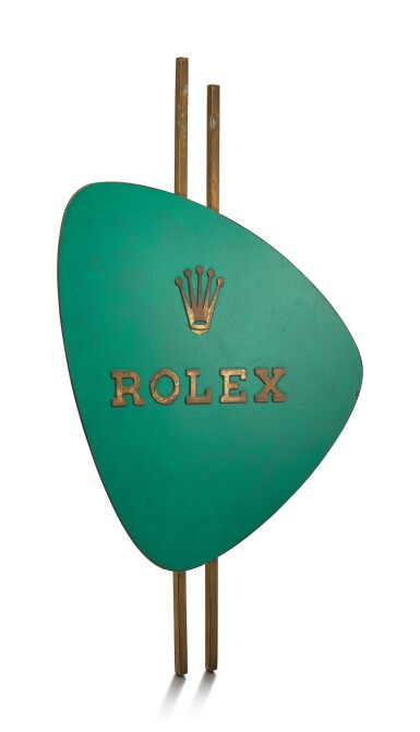 View 2. Thumbnail of Lot 8137. ROLEX   A GILT BRASS AND GREEN ENAMEL RETAILER'S WINDOW DISPLAY, CIRCA 1960.