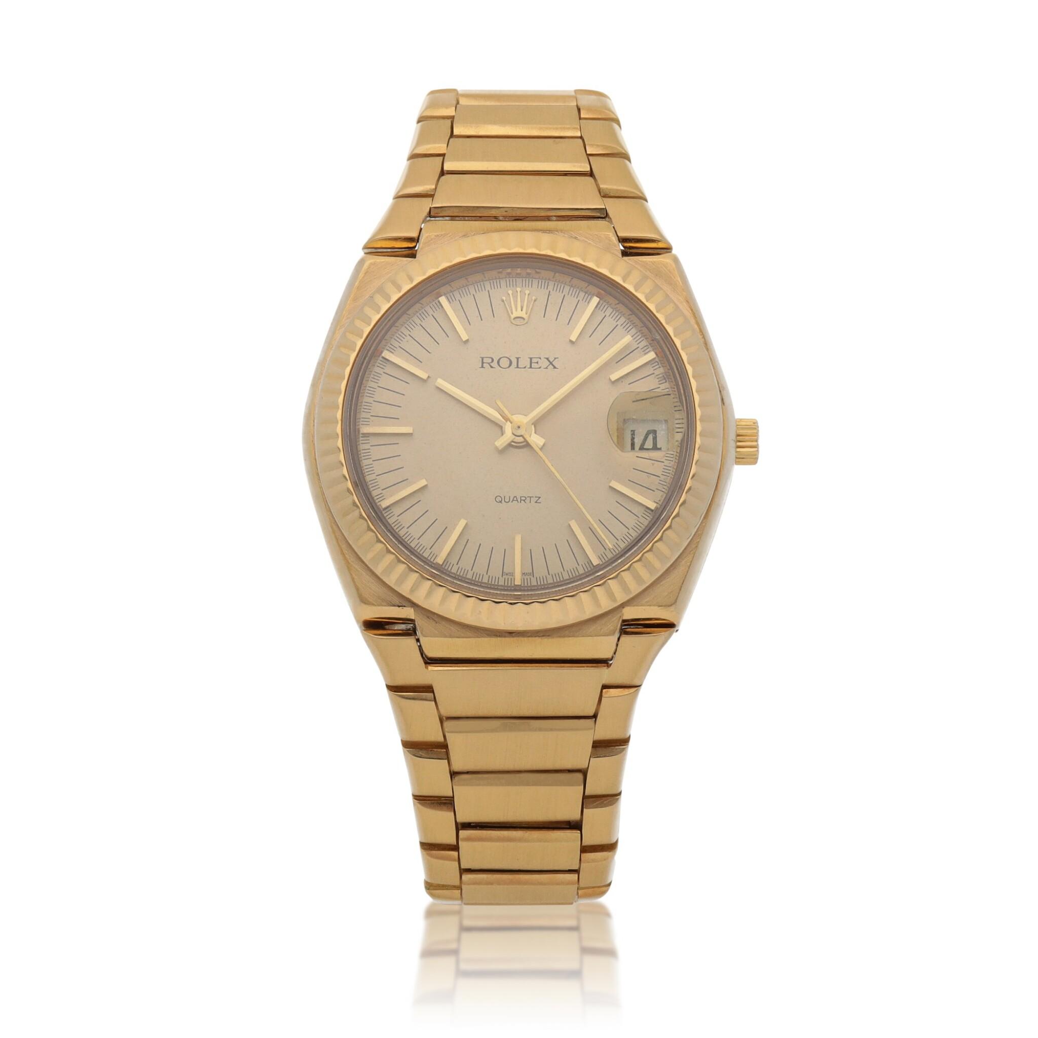 View full screen - View 1 of Lot 428. 'The Texan' Quartz, Ref. 5100 BETA 21 Yellow gold wristwatch with date and bracelet Circa 1970 | 勞力士 5100 BETA 21型號「'The Texan' Quartz」黃金鍊帶腕錶備日期顯示,年份約1970.