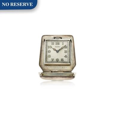 View 1. Thumbnail of Lot 100. A silver purse shaped travel clock, Circa 1930.