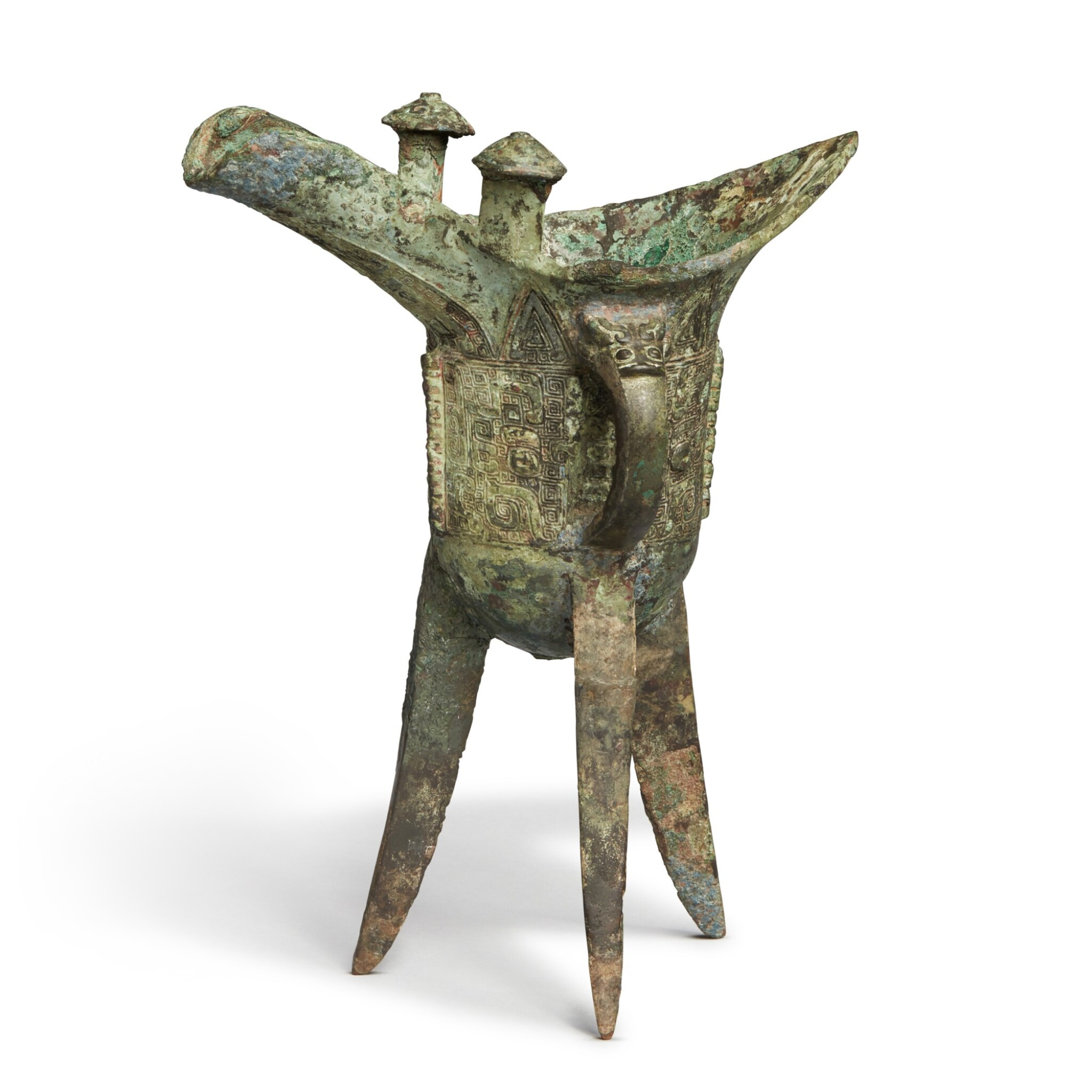 View full screen - View 1 of Lot 5. An archaic bronze ritual wine vessel (Jue),  Late Shang dynasty | 商末 青銅饕餮紋爵.
