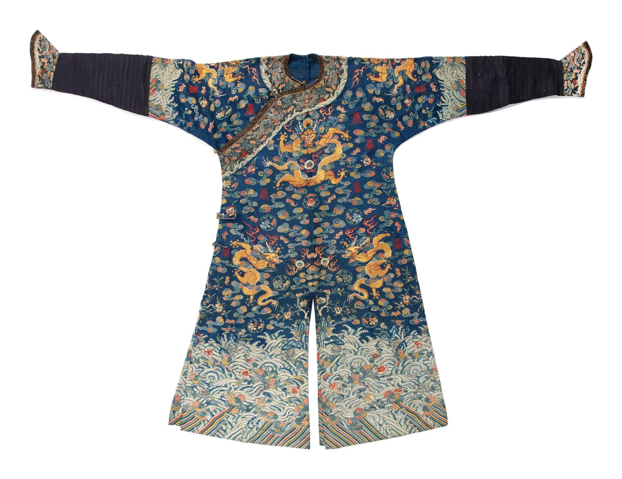 View 1 of Lot 1055. A BLUE-GROUND SUMMER GAUZE 'DRAGON' ROBE, QING DYNASTY, EARLY 19TH CENTURY.