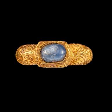 View 1. Thumbnail of Lot 1022. A gold and cabochon star sapphire repoussé ring Champa, 14th century | 十四世紀 占城 金嵌星光藍寶石戒指.