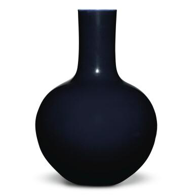 View 1. Thumbnail of Lot 149. A large dark-blue-glazed vase, tianqiuping, Qianlong seal mark and period   清乾隆 藍釉天球瓶  《大清乾隆年製》款.