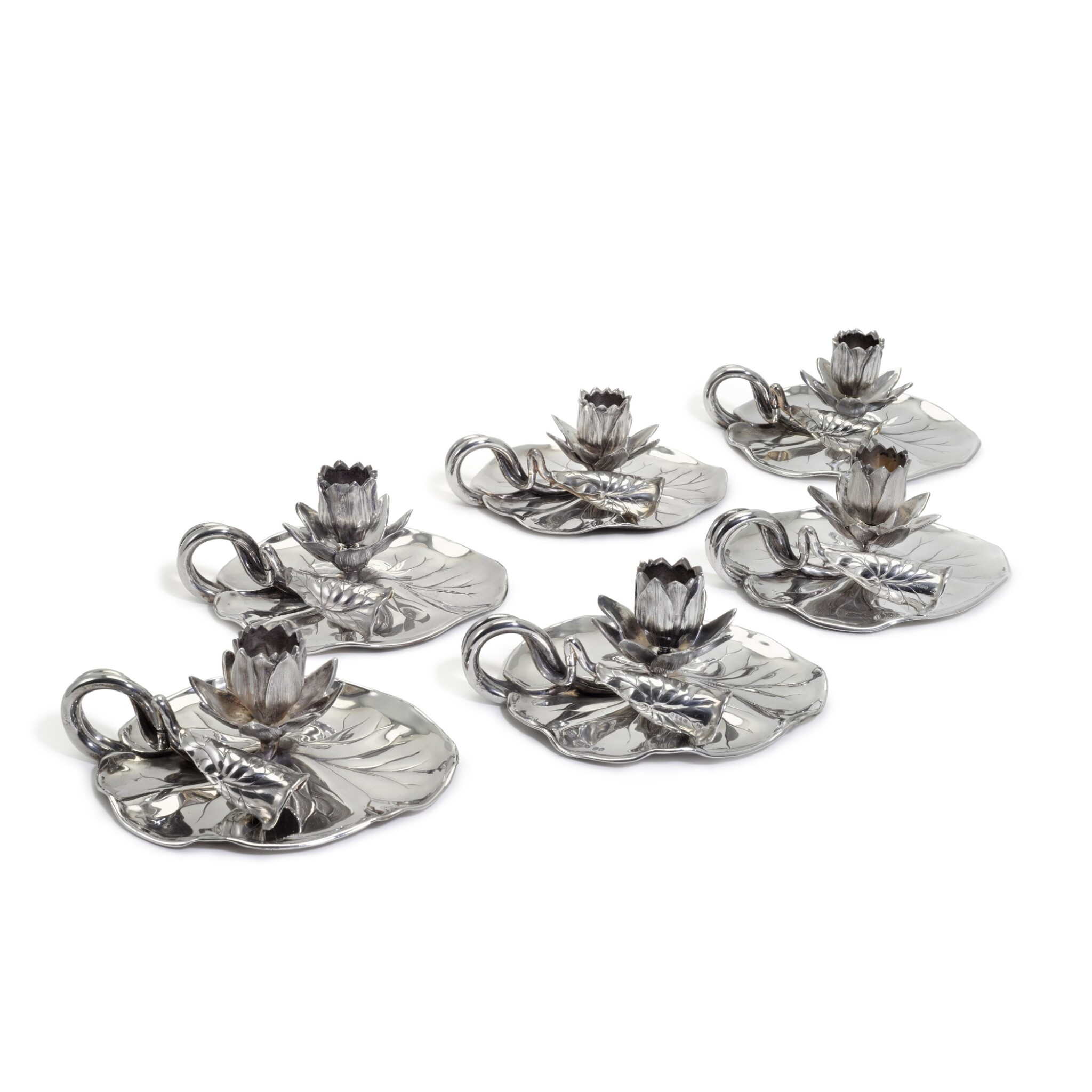 View full screen - View 1 of Lot 71. A set of six Victorian silver novelty 'Lily' chambersticks, R. & S. Garrard & Co London, 1854 and 1863.