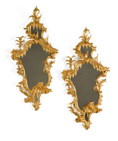 View 1. Thumbnail of Lot 44. A pair of late George II carved giltwood mirrors, circa 1755, in the manner of William and John Linnell.
