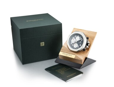 View 5. Thumbnail of Lot 4005. AUDEMARS PIGUET | ROYAL OAK OFFSHORE, A STAINLESS STEEL ALARM DESK CLOCK WITH WOODEN STAND, CIRCA 2017.