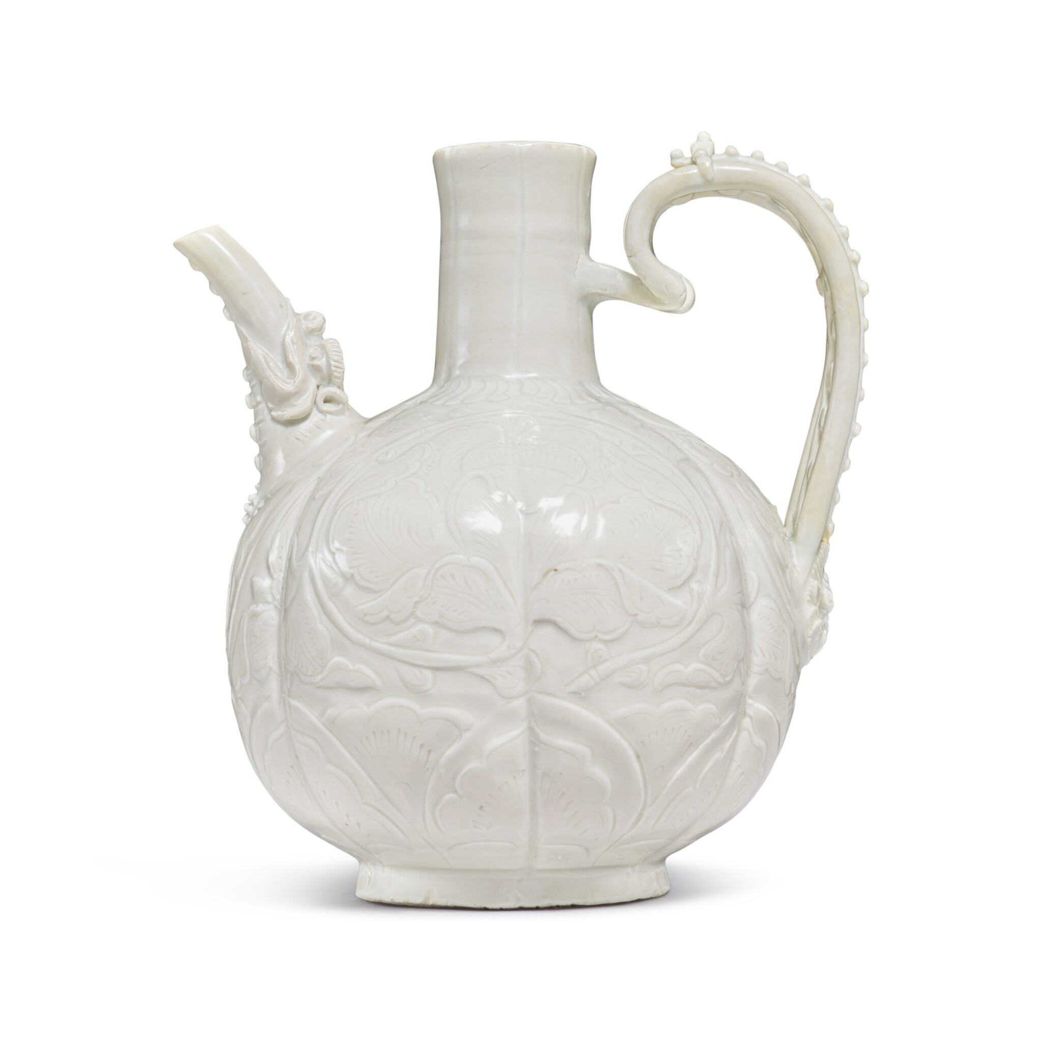 View full screen - View 1 of Lot 185. A finely carved and molded 'Ding' ewer, Northern Song dynasty | 北宋 定窰白釉牡丹紋執壺.