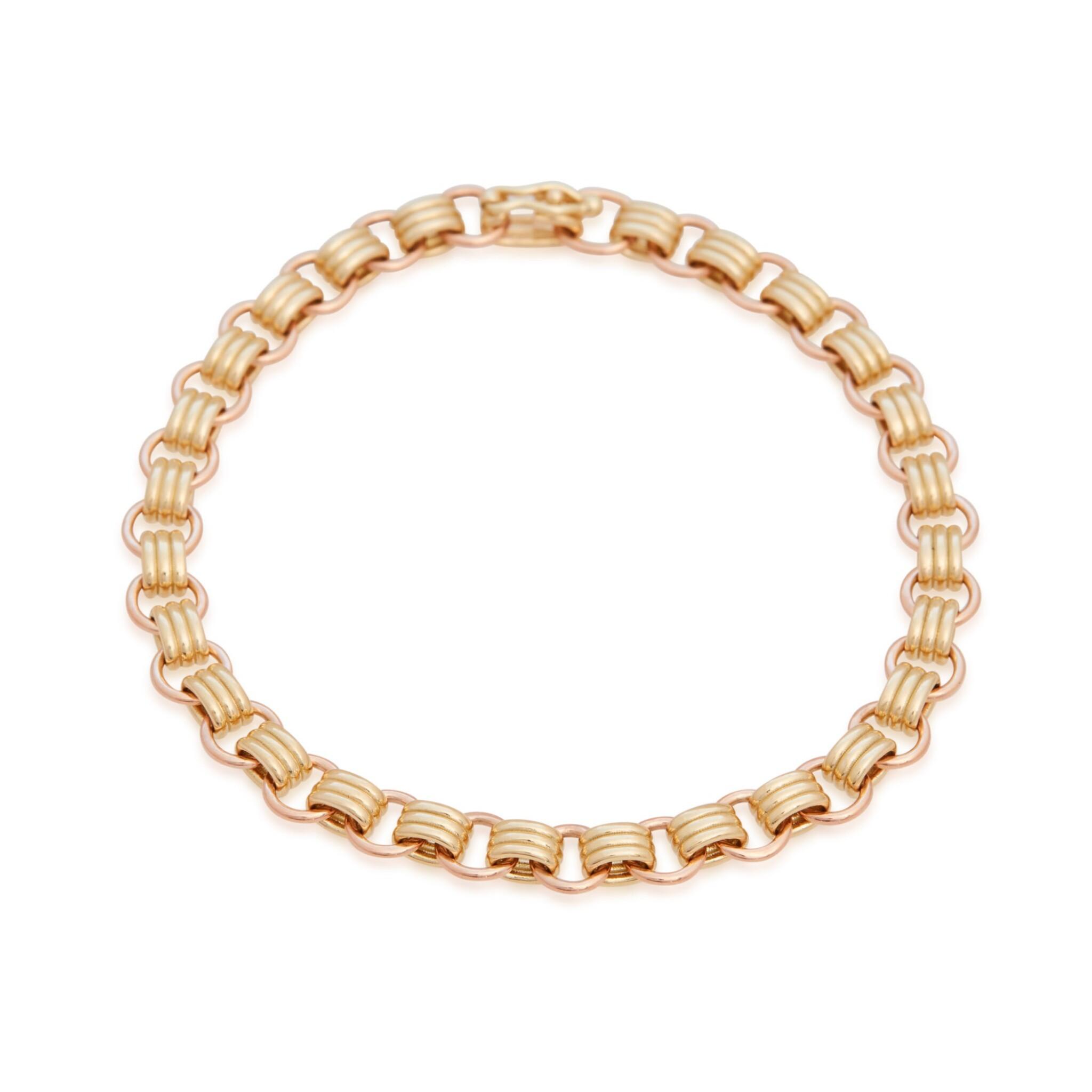 View full screen - View 1 of Lot 19. Sherman Field   18 Karat Yellow and Pink Gold Triple Chain Bracelet.
