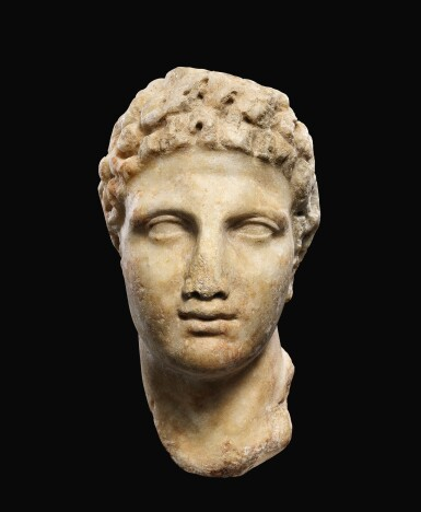 A GREEK MARBLE HEAD OF A YOUTH, CIRCA MID 4TH CENTURY B.C.