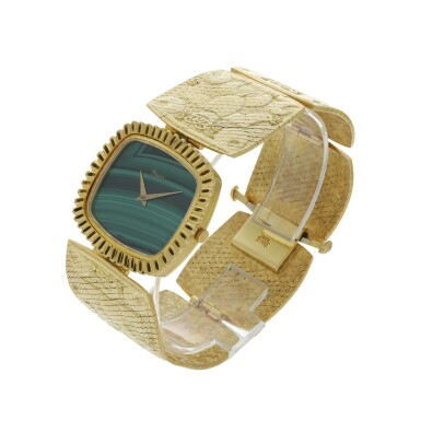 View 2. Thumbnail of Lot 66. PIAGET | REFERENCE 9431 B72 A YELLOW GOLD CUSHION SHAPED BRACELET WATCH WITH MALACHITE DIAL, CIRCA 1971.