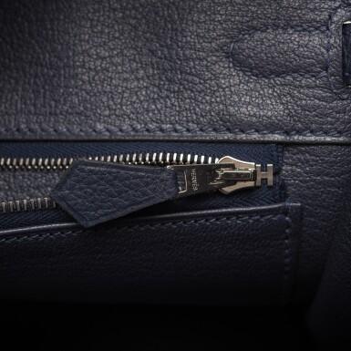 View 8. Thumbnail of Lot 4. Hermès Bleu Nuit Birkin 25cm of Togo Leather with Palladium Hardware.
