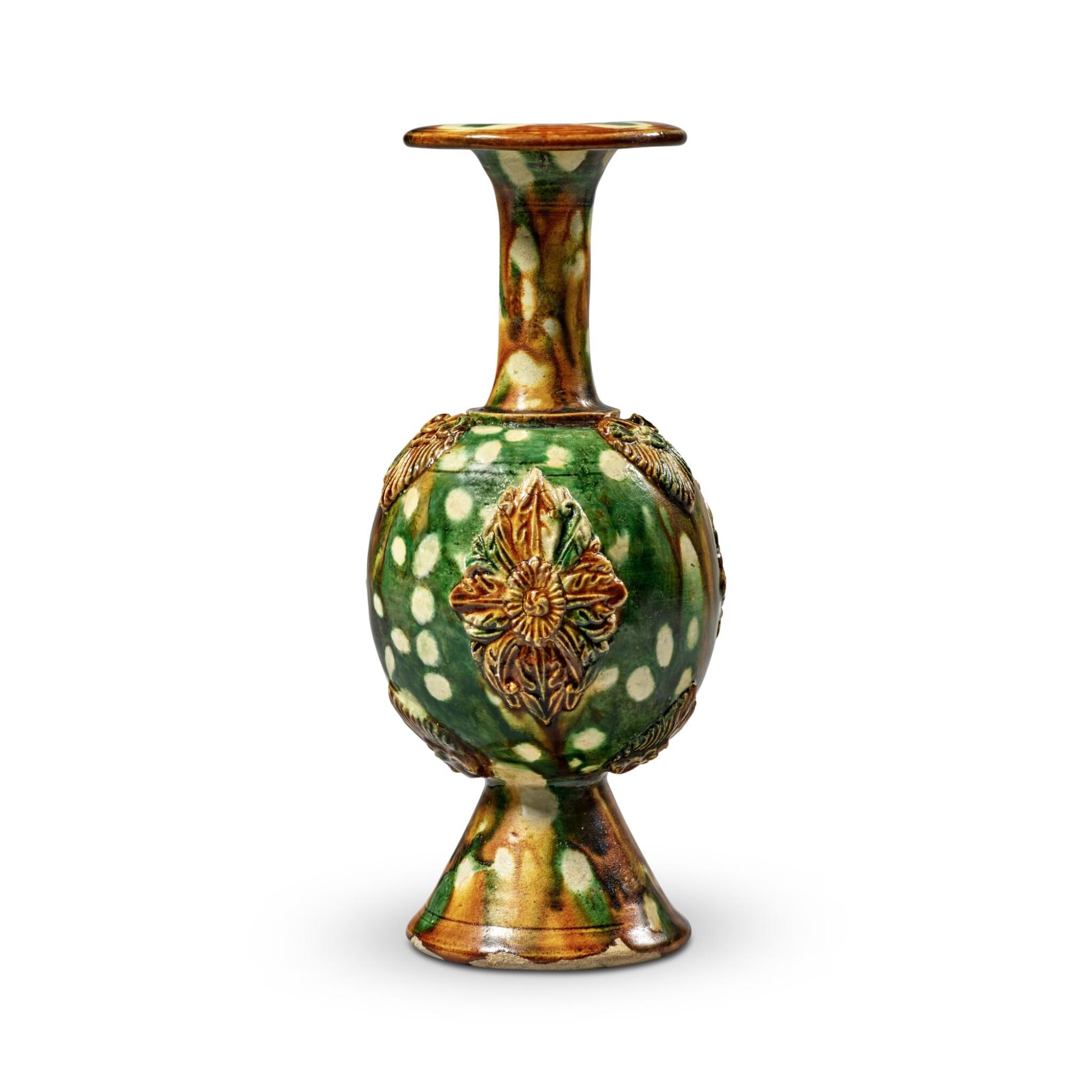 View full screen - View 1 of Lot 172. A rare sancai-glazed pottery bottle vase, Tang dynasty   唐 三彩貼花瓶.