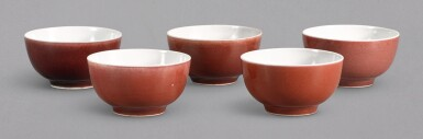A MATCHED SET OF FIVE SMALL COPPER-RED GLAZED CUPS, YONGZHENG MARKS AND PERIOD | 清雍正 紅釉小盃一組五件 《大清雍正年製》款