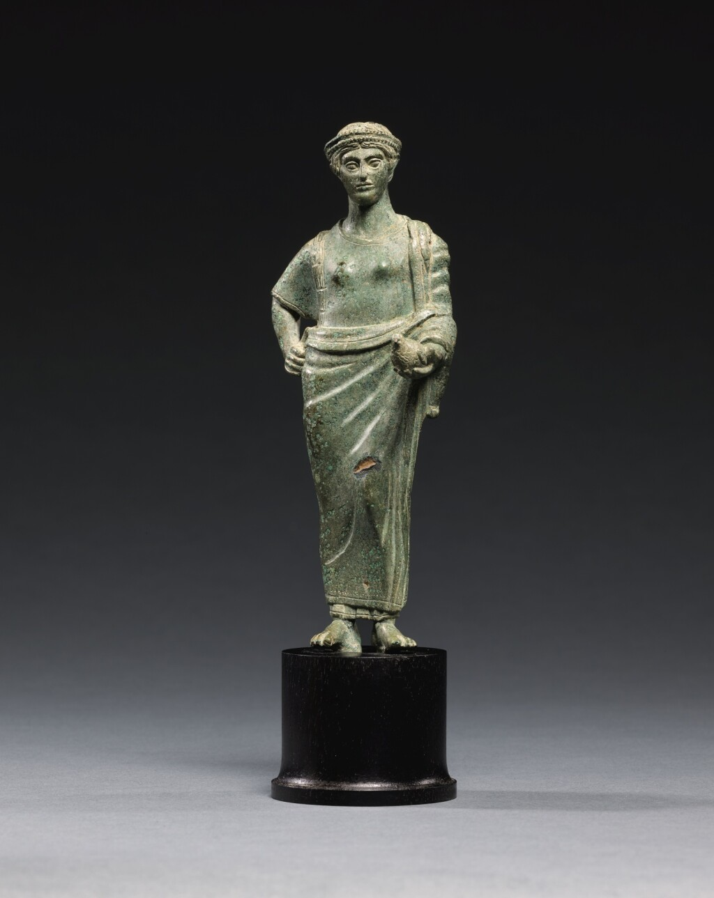 AN ETRUSCAN BRONZE FIGURE OF A WOMAN, CIRCA 425-400 B.C.