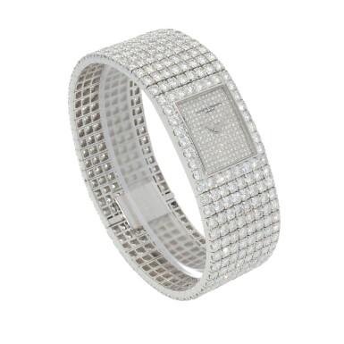 View 5. Thumbnail of Lot 60. Kalla, Ref. 35704-707G White gold and diamond-set bracelet watch Made in 1990 | 江詩丹頓35704-707G型號「Kalla」白金鑲鑽石鍊帶腕錶,1990年製.