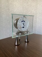 JAEGER-LECOULTRE | ATLANTIS, ATMOS DU MILLÉNAIRE STAINLESS STEEL AND GLASS ATMOS CLOCK WITH 1000 YEAR CALENDAR AND MOON PHASES CIRCA 2002