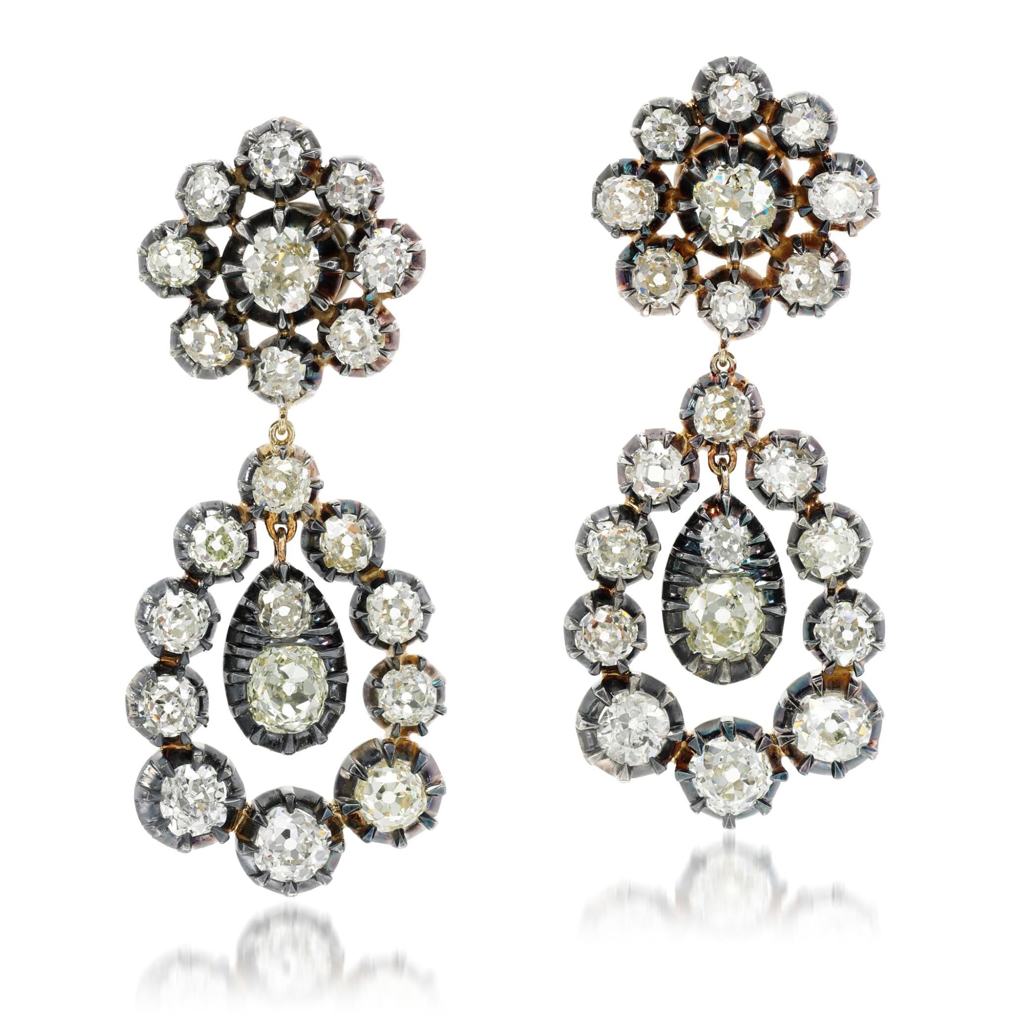 View full screen - View 1 of Lot 81. Pair of diamond earrings.