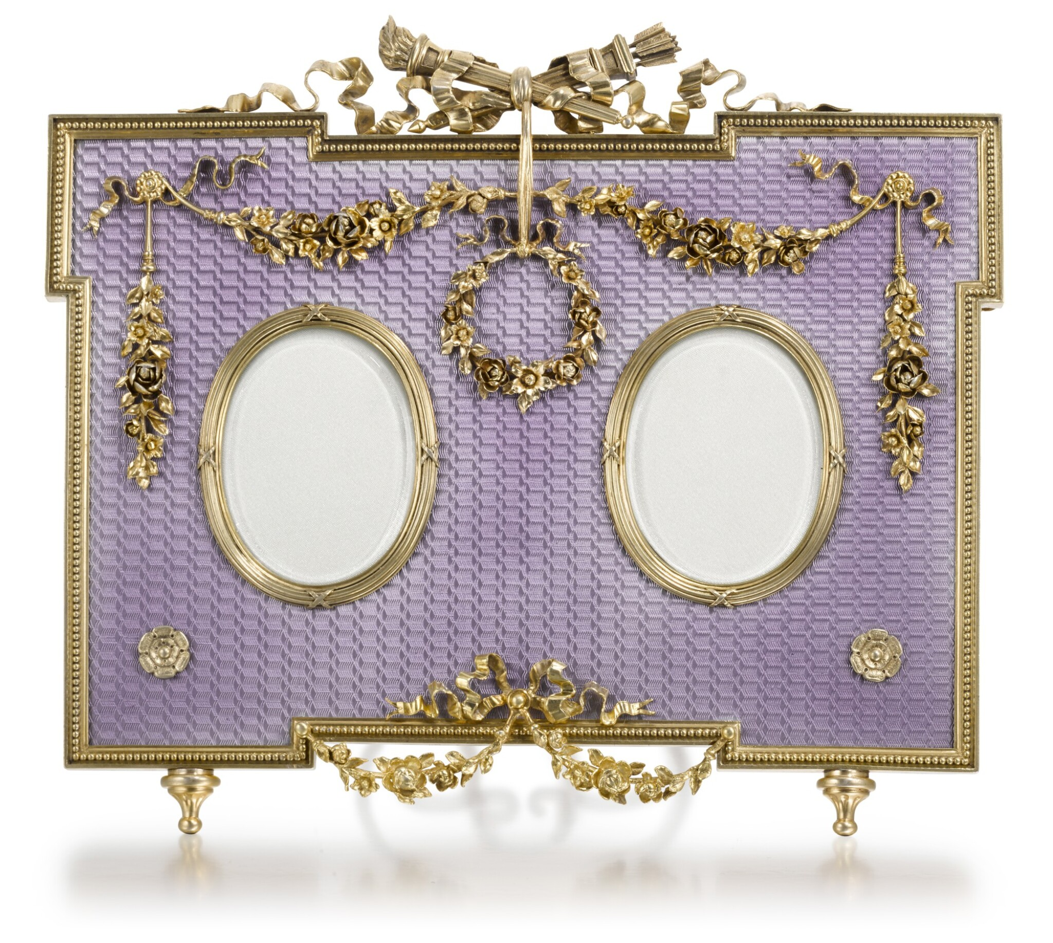View full screen - View 1 of Lot 31. A Fabergé gold-mounted, silver-gilt and guilloché enamel double-frame, workmaster Victor Aarne, St Petersburg, circa 1890.
