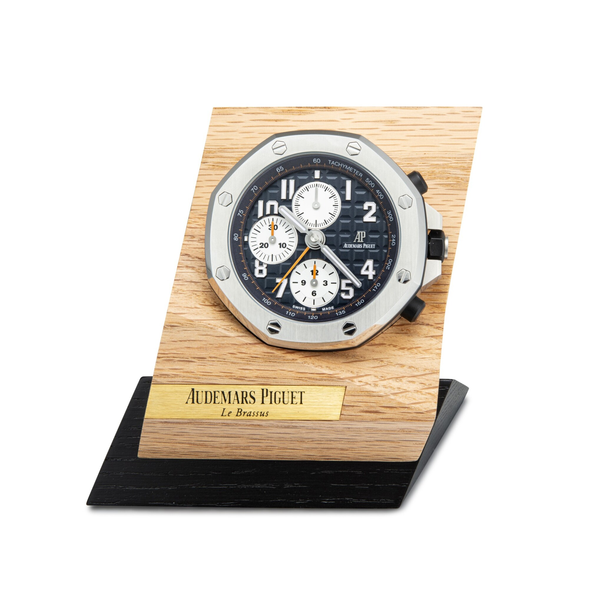 View full screen - View 1 of Lot 4005. AUDEMARS PIGUET | ROYAL OAK OFFSHORE, A STAINLESS STEEL ALARM DESK CLOCK WITH WOODEN STAND, CIRCA 2017.