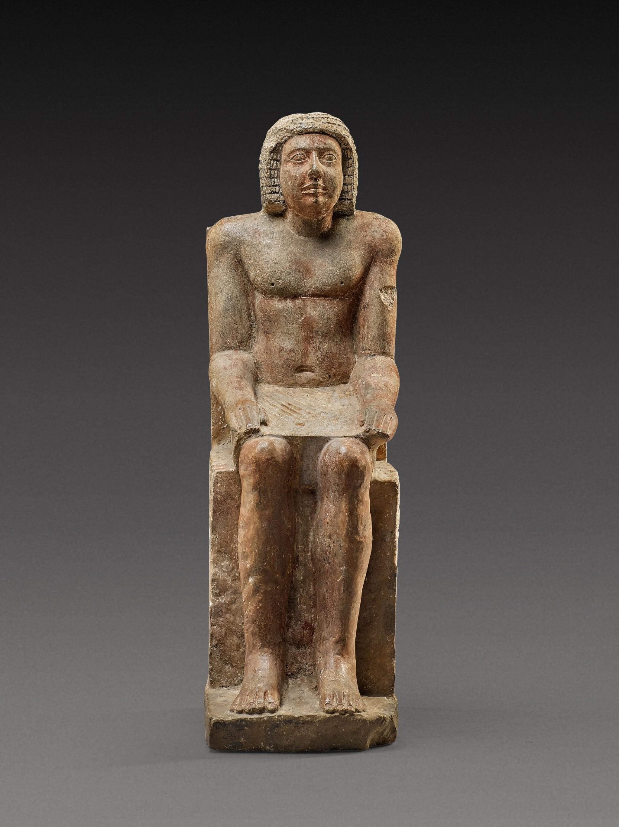 View full screen - View 1 of Lot 54. An Egyptian Polychrome Limestone Figure of Hem-Min, 6th Dynasty, 2360-2195 B.C.  .