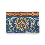 AN IZNIK POLYCHROME POTTERY BORDER TILE WITH COMPOSITE FLOWERHEAD AND KEY FRET RED BORDER | TURKEY, CIRCA 1550-1600