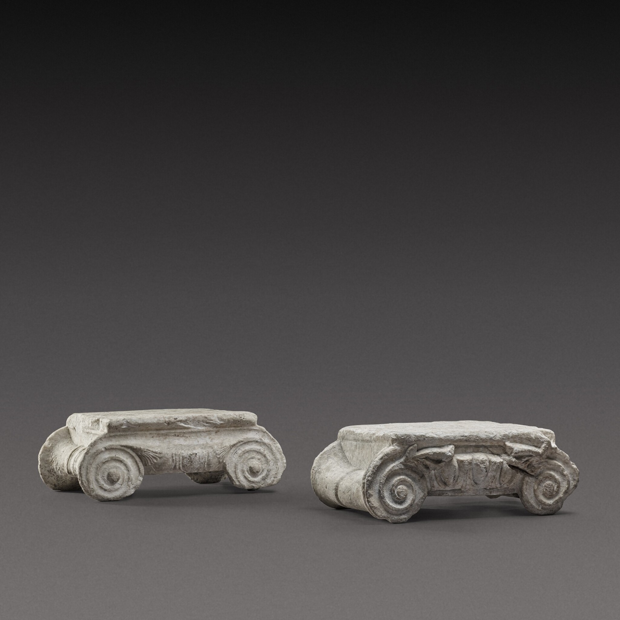 View 1 of Lot 79. Two Ionic Marble Capitals, circa 1st Century A.D..