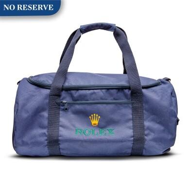 View 1. Thumbnail of Lot 8020. Rolex | A blue canvas duffle bag, Circa 2011 | 勞力士 | 藍色帆布手提袋,約2011年製.