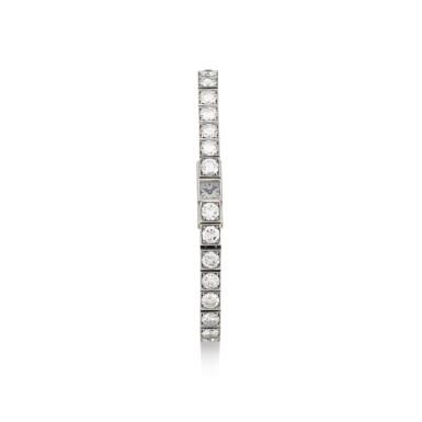 JAEGER-LECOULTRE  |  A PLATINUM DIAMOND-SET BRACELET WATCH, CIRCA 1940