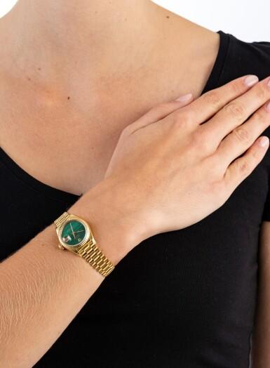 View 4. Thumbnail of Lot 77. Rolex | Montre bracelet de dame or et malachite | Gold and malachite lady's bracelet watch.
