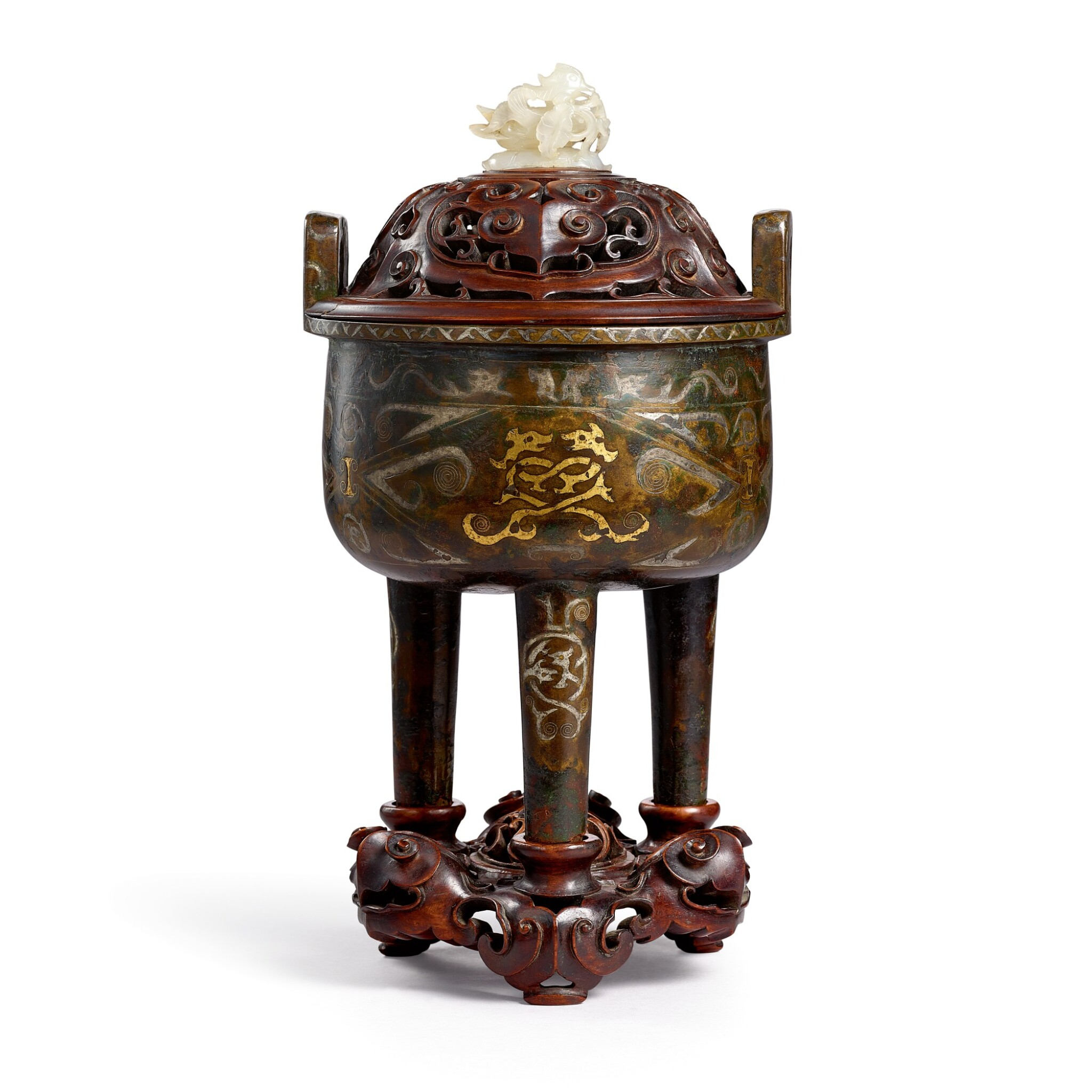 View full screen - View 1 of Lot 3684. A gold and silver-inlaid bronze incense burner, ding Late Ming – early Qing dynasty | 明末至清初 銅錯金銀鏨雲龍紋鼎式爐.