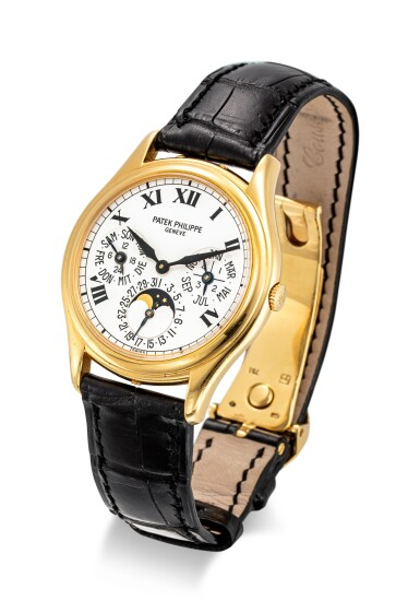 View 2. Thumbnail of Lot 4001. PATEK PHILIPPE | REFERENCE 3940, A YELLOW GOLD PERPETUAL CALENDAR WRISTWATCH WITH MOON PHASES, 24 HOURS AND LEAP YEAR INDICATION, CIRCA 2005.