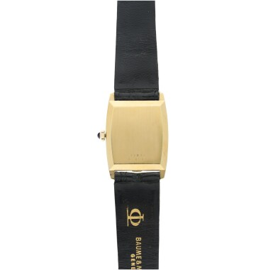 View 5. Thumbnail of Lot 1056. REFERENCE 37073 A YELLOW GOLD OVAL WRISTWATCH WITH LAPIS LAZULI DIAL, CIRCA 1980.