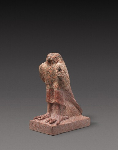 View 1. Thumbnail of Lot 39. A Fragmentary Egyptian Red Granite Figure of the Horus Falcon, Ptolemaic Period, 305-30 B.C..
