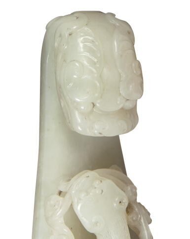 View 10. Thumbnail of Lot 1002. A WHITE JADE 'CHILONG' BELT HOOK,  QING DYNASTY, 18TH CENTURY.