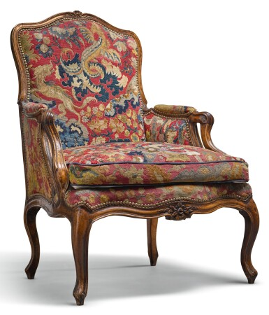 A LOUIS XV CARVED WALNUT FAUTEUIL CIRCA 1750