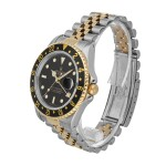 ROLEX | GMT-MASTER II REF 16713, A STAINLESS STEEL AND YELLOW GOLD AUTOMATIC DUAL TIME ZONE WRISTWATCH WITH DATE AND BRACELET CIRCA 1995