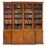 A Regency brass inlaid and ebony strung mahogany breakfront library bookcase, circa 1815