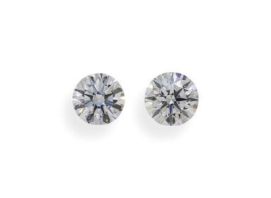 A Pair of 0.90 Carat Round Diamonds, E Color, VS2 Clarity