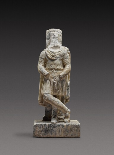 View 1. Thumbnail of Lot 76. A Roman Pavonazzetto Marble Trapezophoros in the Form of a Barbarian, circa 2nd Century A.D..