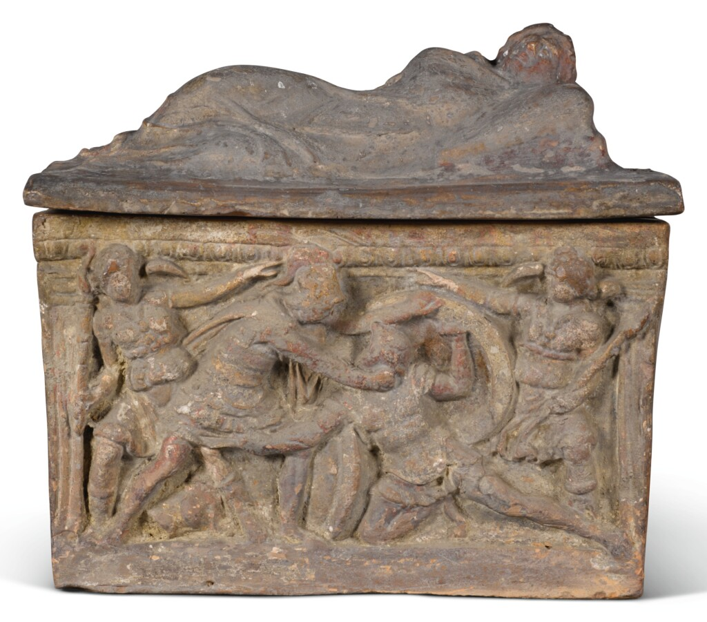 AN ETRUSCAN TERRACOTTA CINERARY URN AND COVER, CIRCA 3RD CENTURY B.C.
