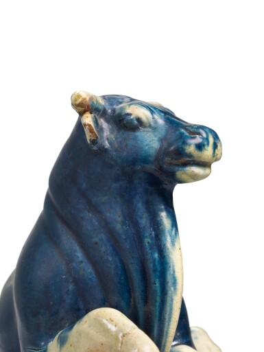 View 4. Thumbnail of Lot 234. AN EXTREMELY RARE BLUE, STRAW AND AMBER-GLAZED BUFFALO, TANG DYNASTY | 唐 三彩加藍臥牛.