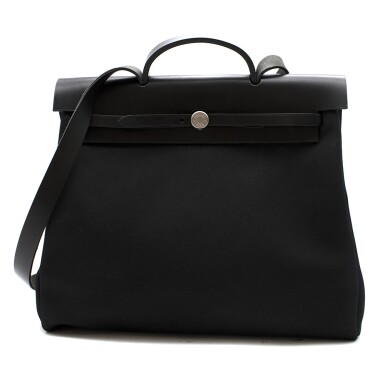 View 1. Thumbnail of Lot 113. HERMÈS | BLACK HERBAG MM 2-IN-1 IN HUNTER COWHIDE WITH PALLADIUM HARDWARE, 1999.